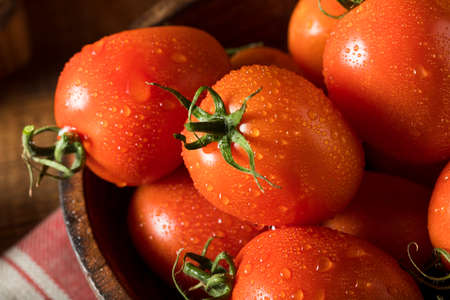 Raw Red Organic Roma Tomatoes Ready for Cooking Stock Photo - 69035771