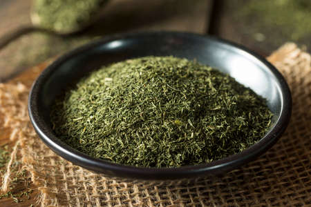 Raw Green Organic Dry Dill Weed in a Bowl
