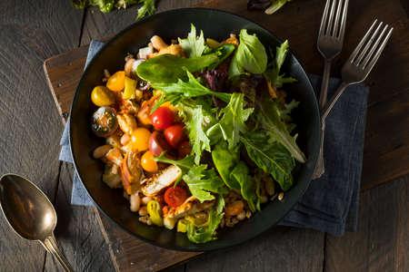 Healthy Organic Mediterranean Buddha Farro Grain Bowl with Lettuce and Chicken