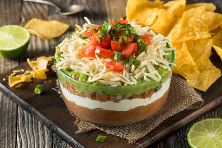 Homemade Mexican 7 Layer Dip with Beans, Sour Cream and Guacamole