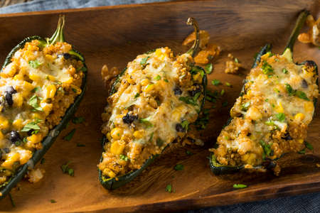 plates of food: Homemade Roasted Quinoa Stuffed Poblano Peppers with Corn and Beans