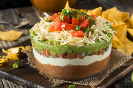 Homemade Mexican 7 Layer Dip with Beans, Sour Cream and Guacamole Stok Fotoğraf - 70286611