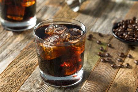 Alcoholic Boozy Black Russian Cocktail with Vodka and Coffee Liquor Foto de archivo