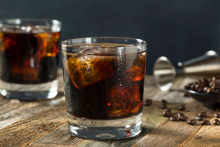 Alcoholic Boozy Black Russian Cocktail with Vodka and Coffee Liquor 스톡 콘텐츠