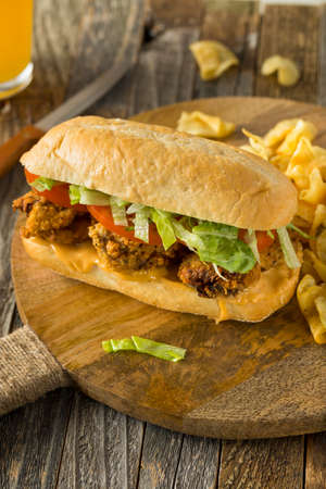 Homemade Fried Oyster Po Boy Sandwich with Lettuce and Tomato Stok Fotoğraf