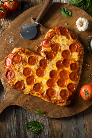 Homemade Heart Shaped Pepperoni Pizza Ready to Eat Stok Fotoğraf