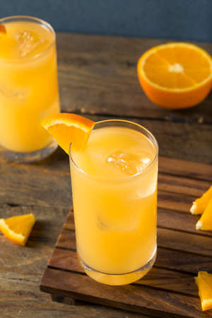 alcohol screwdriver: Homemade Alcoholic Gin and Juice Cocktail with Orange and Grapefruit Stock Photo