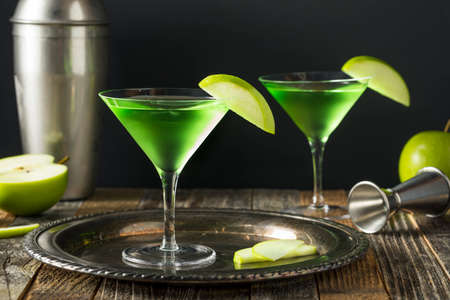 Homemade Green Alcoholic Appletini Cocktail with Apple Garnish