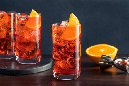 Refreshing Cold Americano Cocktail with an Orange Garnish