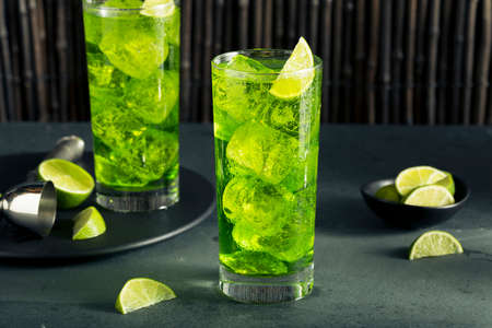 cocktail mixer: Green Melon Japanese HIghball with a Lime Garnish Stock Photo