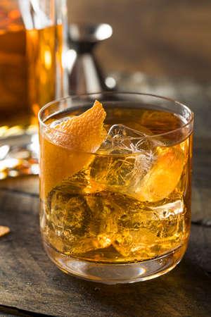 Boozy Homemade Old Fashioned Bourbon on the Rocks with an Orange Garnish Stock Photo