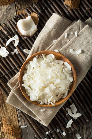 Raw Organic Coconut Flakes in a Bowl for Baking