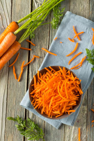 shreds: Raw Organic Orange Shredded Carrots in a Bowl