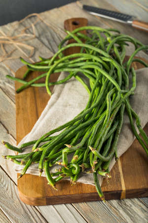 Raw Green Organic Chinese Long Beans Ready to Cook With Stock Photo