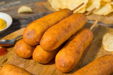 Homemade Deep Fried Corn Dogs with Mustard and Ketchup