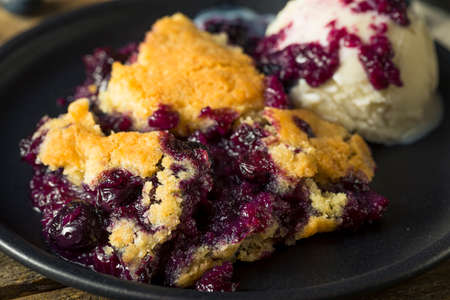 Sweet Homemade Blueberry Cobbler Dessert with Ice Cream