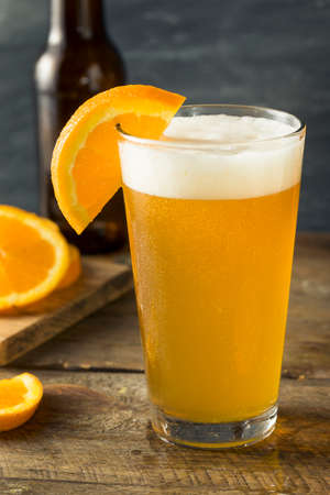 Organic Orange Citrus Craft Beer with a Garnish Imagens