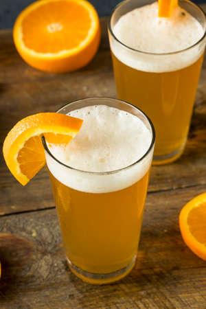 Organic Orange Citrus Craft Beer with a Garnish Stock Photo
