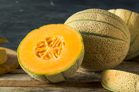 Raw Organic Tuscan Melon Cantaloupe Cut into Pieces Stock Photo