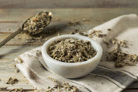 Organic Dry Green Sage in a Bowl Stock Photo