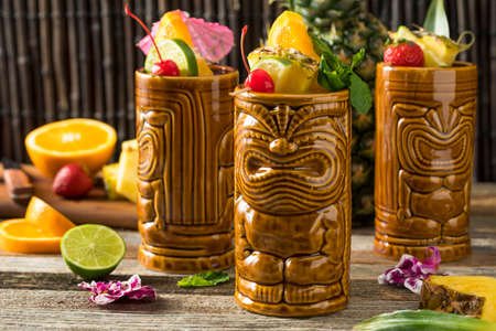 Refreshing Cold Tiki Drink Cocktails with Pineapple Cherry Orange Garnishes