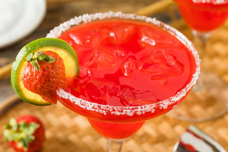 daiquiri alcohol: Homemade Iced Starwberry Margarita with Limes for Garnish Stock Photo