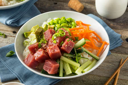 Raw Organic Ahi Tuna Poke Bowl with Rice and Veggies Stock Photo