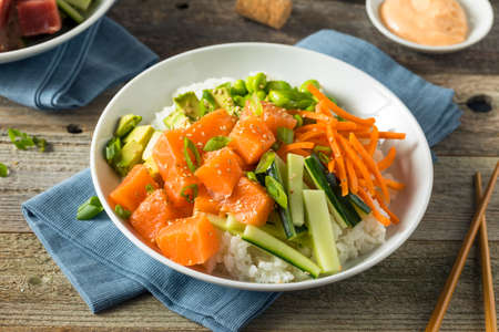 Raw Organic Salmon Poke Bowl with Rice and Veggies