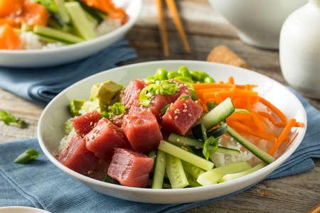 Raw Organic Ahi Tuna Poke Bowl with Rice and Veggies Фото со стока