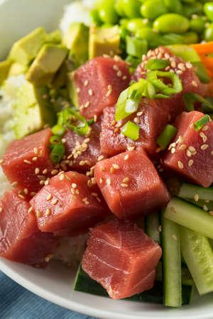 Raw Organic Ahi Tuna Poke Bowl with Rice and Veggies Stock Photo