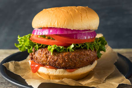 meatless: Healthy Vegan Vegetarian Meat Free Burger with Lettuce Tomato and Onion Stock Photo