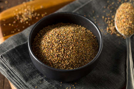 Dry Organic Mixed Ground Pepper Blend in a Bowl