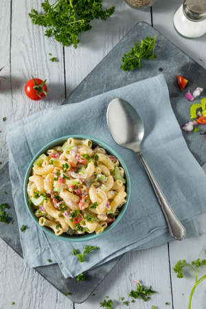 Yummy Homemade Macaroni Salad with Tomato Onion Celery and Parsley Stock fotó