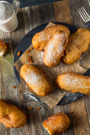 Homemade Deep Fried Yellow Sponge Snack Cakes with Powdered Sugar