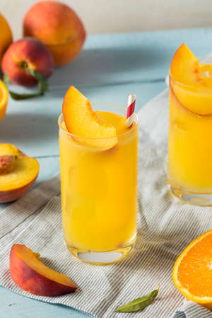 Refreshing Peach and Orange Fuzzy Navel Cocktail with a Garnish Stock Photo