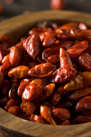 Organic Dry Small Pequin Chili Peppers in a Bowl