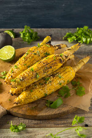 Barbecued Homemade Elote Mexican Street Corn with Mayo and Chili Powder Stock Photo