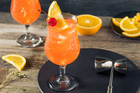 daiquiri alcohol: Cold Refreshing Singapore Sling Cocktail with Rum and Pineapple