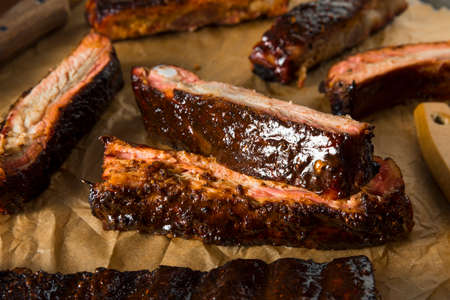 Homemade Smoked Barbecue St. Louis Style Pork Ribs with Sauce Stock Photo