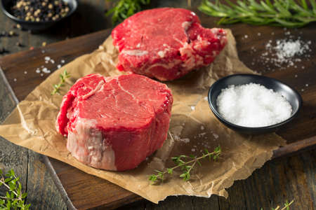 Raw Organic Grass Fed Filet Mignon Steak with Salt and Herbs