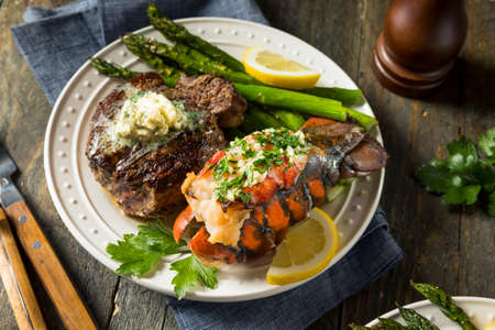 Homemade Steak and Lobster Surf n Turf with Asparagus Foto de archivo