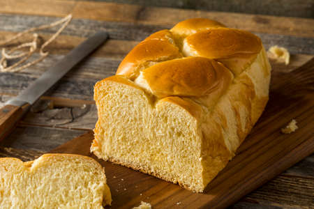 Homemade Sweet Brioche Bread Loaf Cut into Slices 스톡 콘텐츠