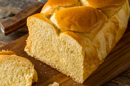 Homemade Sweet Brioche Bread Loaf Cut into Slices Stock Photo