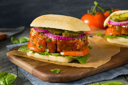 Homemade Savory Meatloaf Sandwich with Lettuce and Tomato Stock Photo