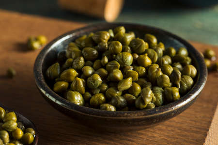 Raw Green Organic Marinated Capers in a Bowl
