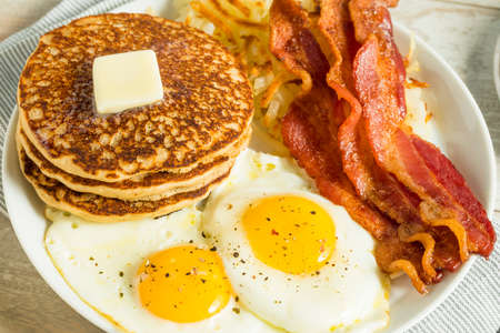 Healthy Full American Breakfast with Eggs Bacon and Pancakes