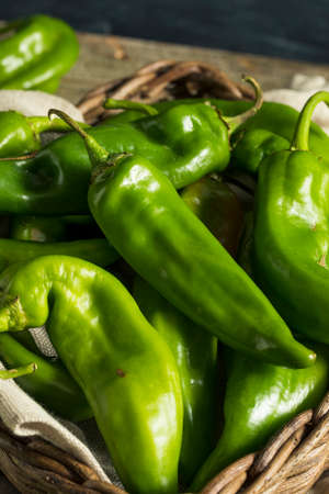 Raw Green Spicy Hatch Peppers in a Basket Stock Photo