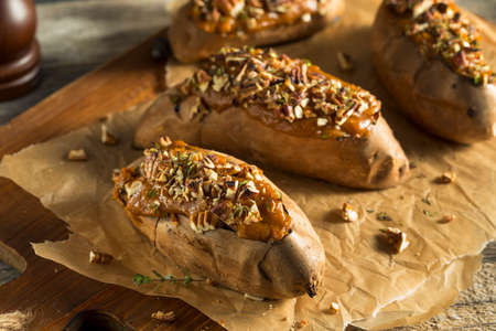 Homemade Baked Sweet Potatoes with Butter Pecans and Herbs