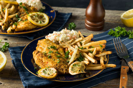 Spicy Homemade BAked  Cajun Catfish with French Fries Stock Photo