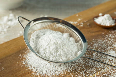 Sweet Organaic Confectioners Powdered Sugar in a Sieve Stock Photo